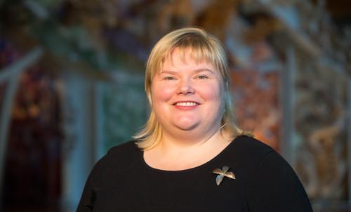 Victoria Leachman, blond white woman aged 35-45 wearing a black shirt