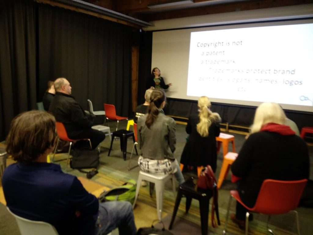 Mandy inspiring folk at the Wellington Open Data meetup on copyright.